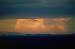 Large storm clouds gather on the horizon of the Serengti plains, Tanzania.