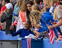 PARIS,  - JUNE 16: Crystal Dunn #19 takes a selfie with a fan during a game between Chile and USWNT at Parc des Princes on June 16, 2019 in Paris, France.