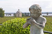 Statue Pan. On the terrasse. View towards Ch Latour. Chateau Pichon Longueville Comtesse de Lalande, pauillac, Medoc, Bordeaux, France
