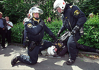 A demonstration held during an EU summit in Gothenburg exploded into violence. Anti-globalisation and anti-EU protesters clashed with police, who then fired live rounds which hit three people. June 2001
