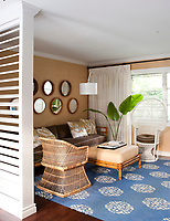 Natural fabrics and furnishings have been used throughout the property. A collection of mismatched circular rattan mirrors create interest on the gallery wall.