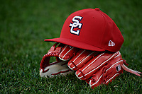 A Syracuse Chiefs hat rests on a glove during a game against the Buffalo Bisons on September 2, 2018 at NBT Bank Stadium in Syracuse, New York.  Syracuse defeated Buffalo 4-3.  (Mike Janes/Four Seam Images)