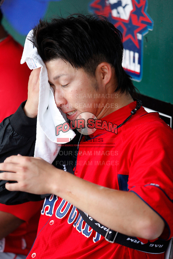 """July 28, 2009:  Starting Pitcher Junichi Tazawa of the Pawtucket Red Sox wipes off the sweat before a game at Coca-Cola Field in Buffalo, NY.  Tazawa was signed out of Japan and making his """"AAA"""" debut with Pawtucket, the International League Triple-A affiliate of the Boston Red Sox.  Photo By Mike Janes/Four Seam Images"""