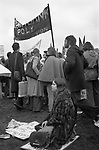 Woman demonstrator smoking and looking depressed sitting down at a Stop the Cuts, Fight for the Right to Work, Defend the NHS Fight for Every Job, rally and march London 1976 Hyde Park London 1970s UK