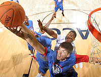 #107 reaches for the rebound during the NBA Top 100 Camp held Friday June 22, 2007 at the John Paul Jones arena in Charlottesville, Va. (Photo/Andrew Shurtleff)