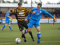 Alloa's Andy Kirk is brought down on the edge of the box by Queen of the South's Derek Young.
