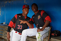 Batavia Muckdogs Terry Bennett (33) and Thomas Jones (49) in the dugout during a rain delay during a game against the West Virginia Black Bears on June 24, 2017 at Dwyer Stadium in Batavia, New York.  The game was suspended in the bottom of the third inning and completed on June 25th with West Virginia defeating Batavia 6-4.  (Mike Janes/Four Seam Images)