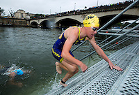 07 JUL 2012 - PARIS, FRA - Jessica Harrison (Poissy Triathlon) (#2, in blue and yellow) heads for transition at the end of the swim at the elite women's French Grand Prix round during the 2012 Triathlon de Paris  at the Pont d'Lena, Paris, France (PHOTO (C) 2012 NIGEL FARROW)