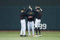 (L-R) Winston-Salem Warthogs outfielders Jagger Rusconi (22), Yoelqui Cespedes (15), and Duke Ellis (11) celebrate their win over the Jersey Shore BlueClaws at Truist Stadium on July 21, 2021 in Winston-Salem, North Carolina. (Brian Westerholt/Four Seam Images)