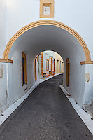 A traditional arch in front of alley in Chora at Kythera island, Greece