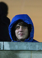 Musician Jake Bugg watches from an Executive Box during the Sky Bet League 2 match between Wycombe Wanderers and Notts County at Adams Park, High Wycombe, England on 15 December 2015. Photo by Andy Rowland.
