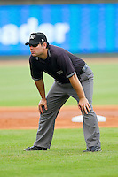 Umpire Jorge Teran handles the calls on the bases during the Carolina League game between the Myrtle Beach Pelicans and the Winston-Salem Dash at BB&T Ballpark on July 7, 2013 in Winston-Salem, North Carolina.  The Pelicans defeated the Dash 6-5 in 8 innings in game two of a double-header.  (Brian Westerholt/Four Seam Images)