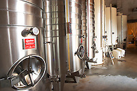 Chateau Mire l'Etang. La Clape. Languedoc. Stainless steel fermentation and storage tanks. Cooling coils for temperature control. France. Europe.
