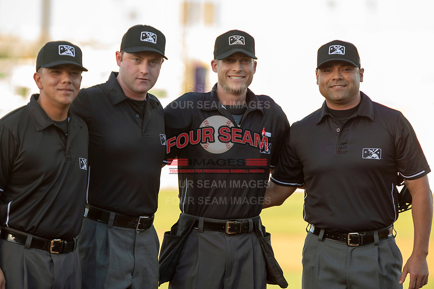 MiLB umpires Andrew Barrett, Joe Gonzalez, Darius Ghani, Luis Hernandez pose for a picture prior to the 2018 California League All-Star Game at The Hangar on June 19, 2018 in Lancaster, California. The North All-Stars defeated the South All-Stars 8-1.  (Donn Parris/Four Seam Images)