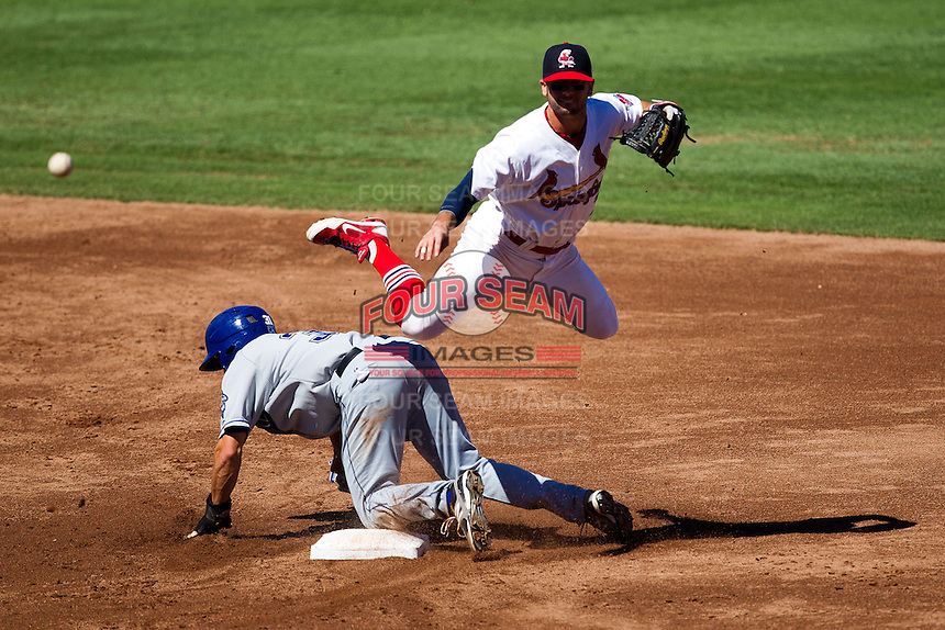 Greg Garcia (7) of the Springfield Cardinals leaps while making a double play during a game against the Tulsa Drillers at Hammons Field on September 9, 2012 in Springfield, Missouri. (David Welker/Four Seam Images)