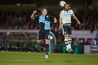 Nikolay Bodurov of Fulham heads the ball clear of Garry Thompson of Wycombe Wanderers during the Capital One Cup match between Wycombe Wanderers and Fulham at Adams Park, High Wycombe, England on 11 August 2015. Photo by Andy Rowland.