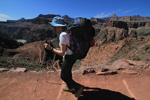Woman backpacker hiking the South Kaibab Trail to the Colorado River and Phantom Ranch Campground, Grand Canyon National Park, northern Arizona, USA . John offers private photo tours in Grand Canyon National Park and throughout Arizona, Utah and Colorado. Year-round.