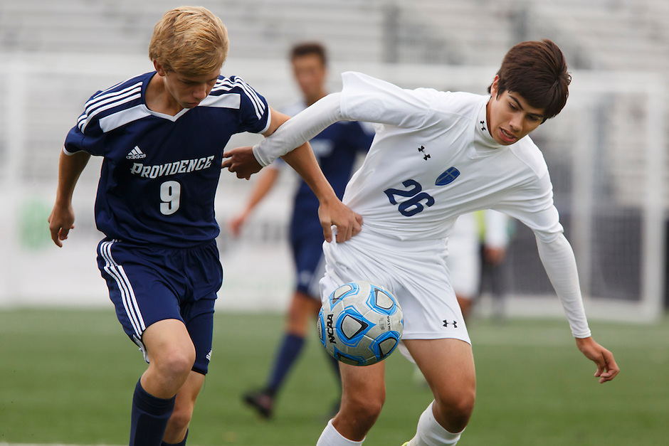 Providence's Alex Lancaster (9) and Mishawaka Marian's Francisco Tavarez (26) play the ball during the IHSAA Class A Boys Soccer State Championship Game on Saturday, Oct. 29, 2016, at Carroll Stadium in Indianapolis. Marian won 4-0. Special to the Tribune/JAMES BROSHER