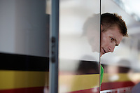 André Greipel (DEU/Lotto-Soudal) peeping out of the bus for the first time in his green jersey<br /> <br /> stage 3: Antwerpen (BEL) - Huy (BEL)<br /> 2015 Tour de France
