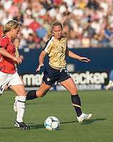 Woman of the match, Christie Rampone (United States, gold) tracks Leni Larsen Kaurin (Norway, red). The United States defeated Norway, 1-0, in Rentschler Stadium, July 14, 2007.