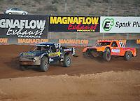 Dec. 11, 2011; Chandler, AZ, USA;  LOORRS pro 2 driver Rob MacCachren (1) and Adrian Cenni (11) during the Lucas Oil Challenge Cup at Firebird International Raceway. Mandatory Credit: Mark J. Rebilas-