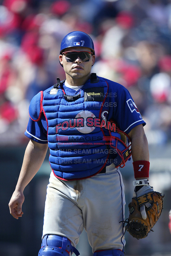 Ivan Rodriguez of the Texas Rangers during a 2002 MLB season game against the Los Angeles Angels at Angel Stadium, in Los Angeles, California. (Larry Goren/Four Seam Images)