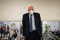 "UNITED STATES - February 9: Sen. Bernie Sanders, I-Vt., makes his way through the Senate subway on the first day of former President Donald Trump's second impeachment trial at the U.S. Capitol in Washington on Tuesday, Feb. 9, 2021. Trump is charged with ""incitement of insurrection"" after his supporters stormed the Capitol in an attempt to overturn November's election result.<br /> CAP/MPI/RS<br /> ©RS/MPI/Capital Pictures"