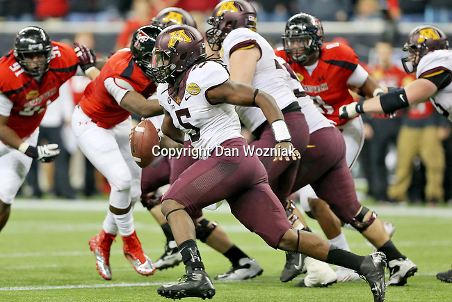 Minnesota Golden Gophers quarterback MarQueis Gray (5) in action during the Meineke Car Care Bowl game of Texas between the Texas Tech Red Raiders and the Minnesota Golden Gophers at the Reliant Stadium in Houston, Texas. Texas leads Minnesota 24 to 17 at halftime.