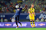 Manchester United defender Eric Bailly (l) heads the ball during the International Champions Cup China 2016, match between Manchester United vs Borussia  Dortmund on 22 July 2016 held at the Shanghai Stadium in Shanghai, China. Photo by Marcio Machado / Power Sport Images