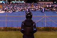 SAN PEDRO SULA, HONDURAS - SEPTEMBER 8: Fans cheer in front of security before a game between Honduras and USMNT at Estadio Olímpico Metropolitano on September 8, 2021 in San Pedro Sula, Honduras.