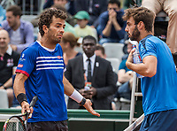 Paris, France, 3 June, 2017, Tennis, French Open, Roland Garros, Men's doubles Horia Tecau (ROU) / Jean-Julien Rojer (NED) (L) in a heavy discussion with their opponents<br /> Photo: Henk Koster/tennisimages.com