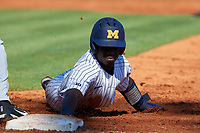 Michigan Wolverines second baseman Ako Thomas (4) dives back to first on a pickoff attempt throw during a game against Army West Point on February 18, 2018 at Tradition Field in St. Lucie, Florida.  Michigan defeated Army 7-3.  (Mike Janes/Four Seam Images)