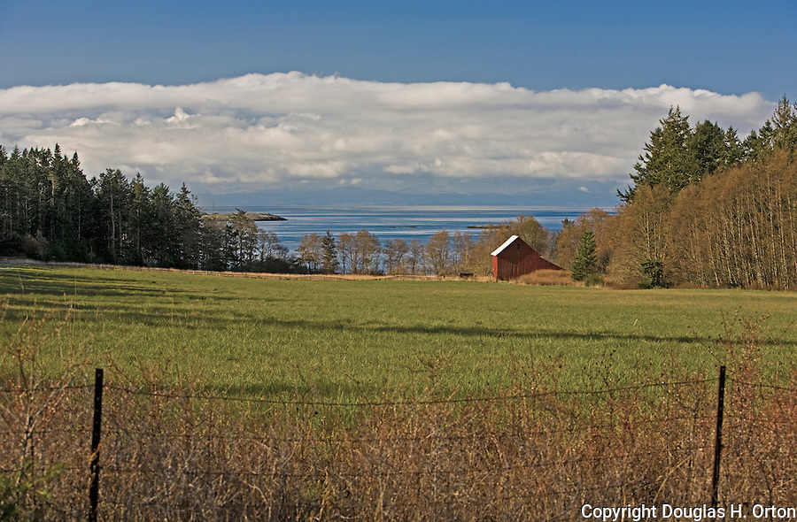 Pastoral farm overlooks McKay Harbor and the Strait of Juan de Fuca on the south end of Lopez Island in Washington State's San Juan Islands group.