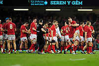 Pictured: Rob Evans and Dan Biggar of Wales celebrate at full time during the Guinness six nations match between Wales and England at the Principality Stadium, Cardiff, Wales, UK.<br /> Saturday 23 February 2019