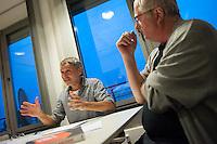 """Chefredakteur der Tageszeitung """"junge Welt"""" Arnold Schoelzel (rechts) und der Herausgeber Dietmar Koschmieder (links) im Gespraech zum Relaunch am 4. Oktober 2014.<br /> 29.9.2014, Berlin<br /> Copyright: Christian-Ditsch.de<br /> [Inhaltsveraendernde Manipulation des Fotos nur nach ausdruecklicher Genehmigung des Fotografen. Vereinbarungen ueber Abtretung von Persoenlichkeitsrechten/Model Release der abgebildeten Person/Personen liegen nicht vor. NO MODEL RELEASE! Don't publish without copyright Christian-Ditsch.de, Veroeffentlichung nur mit Fotografennennung, sowie gegen Honorar, MwSt. und Beleg. Konto: I N G - D i B a, IBAN DE58500105175400192269, BIC INGDDEFFXXX, Kontakt: post@christian-ditsch.de<br /> Urhebervermerk wird gemaess Paragraph 13 UHG verlangt.]"""