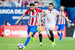 Yannick Ferreira Carrasco (l) of Atletico de Madrid runs past  Pablo Sarabia Garcia and Sergio Escudero Palomo (r) of Sevilla FC during their La Liga match between Atletico de Madrid and Sevilla FC at the Estadio Vicente Calderon on 19 March 2017 in Madrid, Spain. Photo by Diego Gonzalez Souto / Power Sport Images