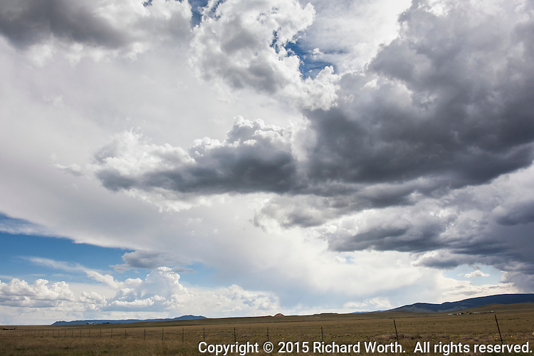 Clouds roil over the high desert west of Laramie, east of Rawlins in the sprawling high desert of southern Wyoming.