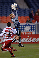 Colorado goalkeeper Joe Cannon cuts off a cross to FC Dallas forward Roberto Mina. The Colorado Rapids drew 0-0 with FC Dallas in the first game of the Western Conference Semi-finals Invesco Field at Mile High, Denver, Colorado, September 22, 2005.