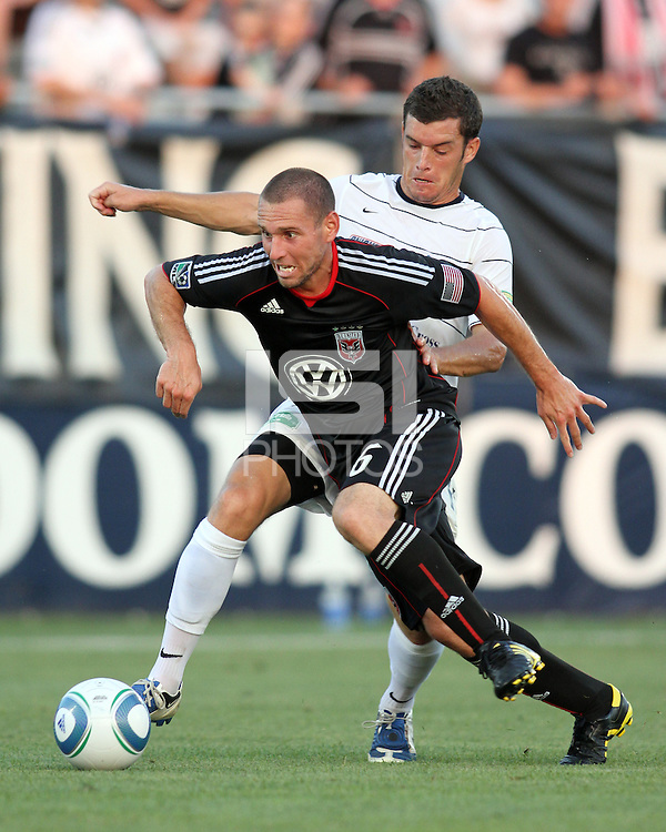 Kurt Morsink #6 of D.C. United is tackled by Jason Hotchkin #11 of the Harrisburg City Islanders during a US Open Cup match at the Maryland Soccerplex on July 21 2010, in Boyds, Maryland. United won 2-0.