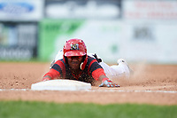Batavia Muckdogs shortstop Marcos Rivera (8) slides head first into third base after hitting a triple during a game against the Tri-City ValleyCats on July 16, 2017 at Dwyer Stadium in Batavia, New York.  Tri-City defeated Batavia 13-8.  (Mike Janes/Four Seam Images)
