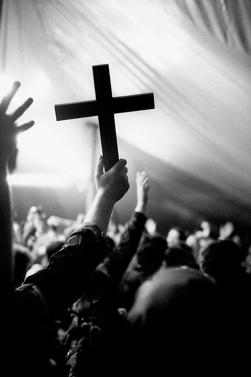 © John Angerson.<br /> Wooden cross at a 'Celebrate Jesus' Easter rally, held annually in a giant marquee at Cornhill Manor , Northamptonshire.