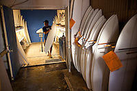 Surfboard shaper Eric Arakawa walking out of the shaping room in his Waialua factory