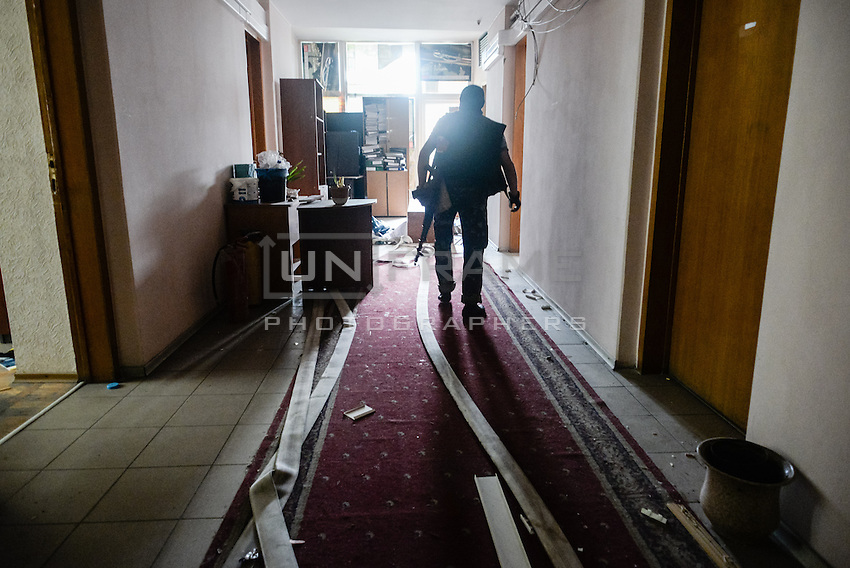"""A member of special pro-Russian battalion """"Vostok"""" seen during the military coup in DNR (Donetsk Peoples Republic), taking over town hall, held by another group of pro-Russian activists."""