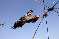 NEPAL, Terai, Chitwan, Hindu festival Dashain, children on swing/ Nepal, Terai, Dorf Kaparphori, Kinder auf einer Schaukel aus Bambusstangen und Kokosseilen, die jaehrlich zum Hindufest Dashain aufgestellt werden