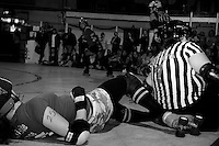"""San Francisco ShEvil Dead skater """"Exquisite Corpse"""" takes a fall as she tries to score on the Oakland Outlaws in the Bay Area Derby Girls season opener  on April 26th, 2008. The ShEvil Dead lost 66-103 against the Outlaws...(©Matt McKnight, 2008)"""