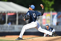 Asheville Tourists starting pitcher Antonio Santos (10) delivers a pitch during a game against the Hagerstown Suns  at McCormick Field on May 13, 2017 in Asheville, North Carolina. The Suns defeated the Tourists 9-5. (Tony Farlow/Four Seam Images)