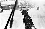 People cross a road in a heavy snow in Otaru.<br /> <br /> Les gens traversent une route dans une neige épaisse à Otaru.