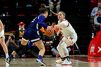 COLLEGE PARK, MD - JANUARY 26: Faith Masonius #13 of Maryland defends against Veronica Burton #12 of Northwestern during a game between Northwestern and Maryland at Xfinity Center on January 26, 2020 in College Park, Maryland.