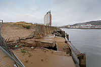 The damaged wall in Swansea Docks, Wales, UK. Tuesday 19 February 2019