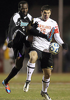 COLLEGE PARK, MD - NOVEMBER 25, 2012: Jake Pace (20) of the University of Maryland is tackled from behind by Jhamie Hyde (5) of Coastal Carolina University during an NCAA championship third round match at Ludwig Field, in College Park, MD, on November 25. Maryland won 5-1.